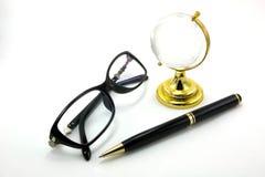 Exponeringsglas och penna Royaltyfri Foto