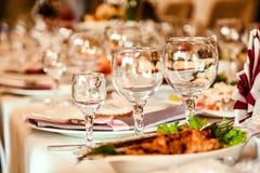 Exponeringsglas på en portiontabell Royaltyfri Fotografi