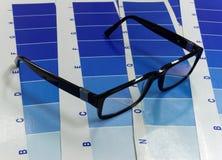 Exponeringsglas på ett cyan tryck för prov Royaltyfri Bild