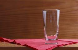 Exponeringsglas på röd servett Royaltyfri Foto