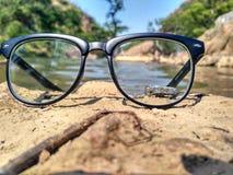 Exponeringsglas på sand Arkivfoto