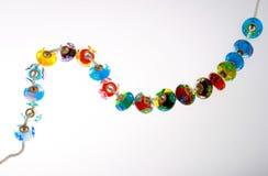 Exponeringsglas pryder med pärlor stränger på Royaltyfria Foton