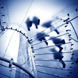 Exponeringsglas röra sig i spiral trappuppgången Arkivbild