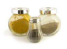 Exponeringsglas skorrar för kryddor Royaltyfri Foto