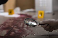 exponeringsglas som ser förstora Arkivfoto