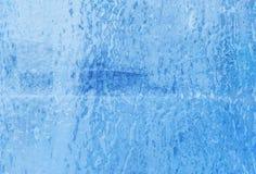 Exponeringsglas som täckas med is arkivfoto