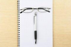 exponeringsglasanteckningsbokpenna Fotografering för Bildbyråer