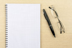 exponeringsglasanteckningsbokpenna Arkivbild