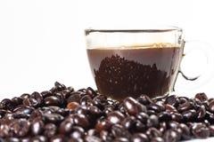 Exponeringsglaset rånar av kaffe och kaffebönan royaltyfri foto