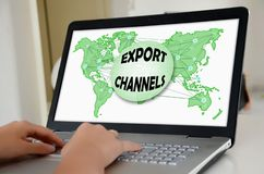 Export channels concept on a laptop screen. Hands on a laptop with screen showing export channels concept royalty free stock image