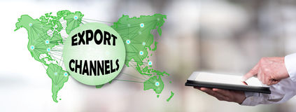 Export channels concept with man using a tablet Royalty Free Stock Image