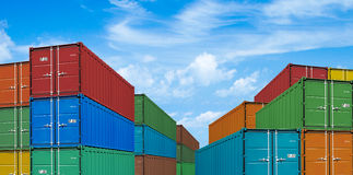 Export or import shipping cargo container stacks. In port Stock Photos
