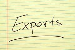Exportaciones en un cojín legal amarillo fotos de archivo