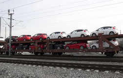 Exporting vehicles to other markets. Automobiles being transported by rail Stock Photography
