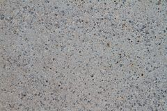 Exposed aggregate concrete. Detailaunfnahme the texture of exposed aggregate concrete Royalty Free Stock Image