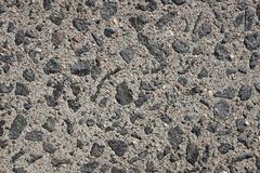 Exposed aggregate concrete paving background. Exposed aggregate concrete paving, with small stones and grit as abstract background texture Stock Image