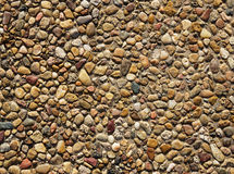 Exposed Aggregate Concrete. With rounded pebbles background texture Stock Image