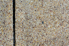 Exposed aggregate finish on the floor Stock Image