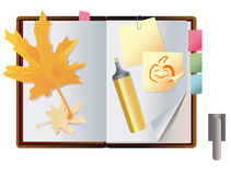 Exposed autumn notebook Stock Images