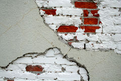 Exposed brick wall with paint. A brick wall with peeling paint Royalty Free Stock Image