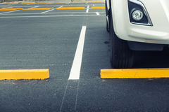 Exposed car parking and straight line background, Car stopper. Royalty Free Stock Photo