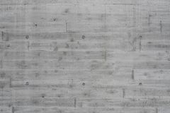 Exposed concrete with pattern texture. Raw grey exposed concrete with pattern texture background Royalty Free Stock Photo