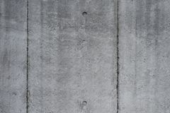 Exposed concrete with pattern texture. Raw grey exposed concrete with pattern texture background Royalty Free Stock Photos