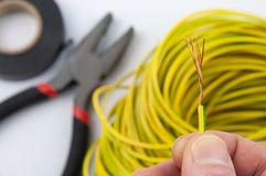Exposed copper wire in the hand close-up royalty free stock photography