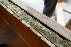 Exposed drywall insulation during window change. In an old wooden house. Home renovation, sustainable living, energy efficiency concept royalty free stock photography