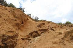 Exposed cliff face of a bluff. Exposed extured cliff face of a bluff looking up stock photos