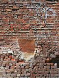 Exposed Old Brickwork With Rough Mortared Joints. Very old exposed brickwork with rough bulging mortar between joints royalty free stock image