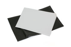 Exposed photographic paper. Several sheets of old black and white photographic paper exposed to light Stock Image