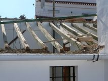 Exposed Roof beams and blue sky. Exposed roof beams after demolishing old roof tiled with arabic style tiles Royalty Free Stock Image