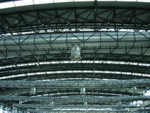 Exposed roof structure. A view of the the exposed steel work and building infrastructure supporting a large airport terminal in Prague Stock Photography