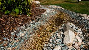Dried up riverbed. Exposed stones and rocks of a dry riverbed royalty free stock photography
