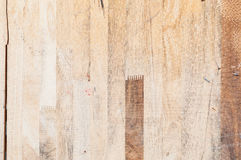 Exposed wooden wall exterior, patchwork of raw wood forming a beautiful parquet wood pattern Royalty Free Stock Photography