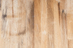 Exposed wooden wall exterior, patchwork of raw wood forming a beautiful parquet wood pattern stock image