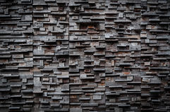 Exposed wooden wall exterior, patchwork of raw wood forming a beautiful parquet wood pattern royalty free stock images