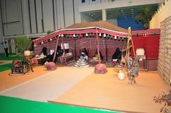 Exposição de Abu Dhabi International Hunting e do cavaleiro (ADIHEX) - Abu Dhabi Tourism & barraca da autoridade da cultura imagem de stock royalty free