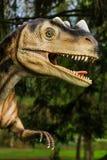 Exposição do dinossauro no parque botânico Fotografia de Stock