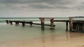 Exposição longa do molhe velho da praia de Mentone Foto de Stock Royalty Free