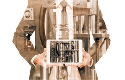 Exposición doble del hombre de negocios con el equipo industrial fotografía de archivo libre de regalías