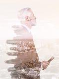 Exposición doble del hombre de negocios mayor Imagen de archivo