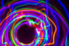 Exposición larga del neón LED en fondo negro Fotos de archivo