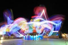 Exposición larga del parque de atracciones Imagen de archivo libre de regalías