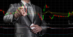 Exposição dobro do homem de negócios com carta do mercado de valores de ação Fotos de Stock Royalty Free
