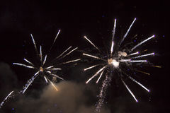 Happy Birthday Exposion. Two big fireworks expode in a sky with spakrs and smoke royalty free stock image