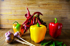 Exposition close up of fresh organic peppers, mont leave, garlic on wood background. Healthy cocking,, chili pepper, red and green Stock Photo