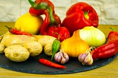 Exposition close up of fresh organic vegetables, composition with assorted raw organic vegetables, red pepper, onion and garlic, g. Reen pepper and red hot chili Royalty Free Stock Images