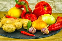 Exposition close up of fresh organic vegetables, composition with assorted raw organic vegetables, red pepper, onion and garlic, g. Reen pepper and red hot chili Royalty Free Stock Photos
